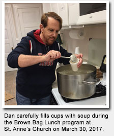 Dan fills cups with soup during the Brown Bag Lunch program at St. Anne's Church.