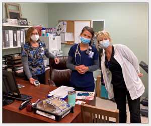 Nurse Managers in their office wearing masks