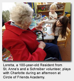 Loretta, a 100-year-old Resident from St. Anne's and a Schreiber volunteer, plays with Charlotte during an afternoon at Circle of Friends Academy.